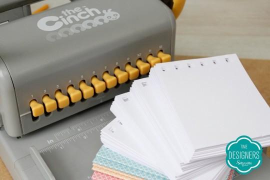 Páginas, capas e ante capas furadas na encadernadora The Cinch