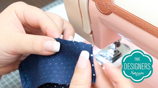 Abra tecido costure dois cortes retos
